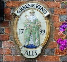 greene king pub sign